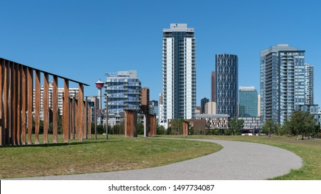 Panoramic image of the skyline of Calgary on a sunny day with blue sky, Alberta, Canada