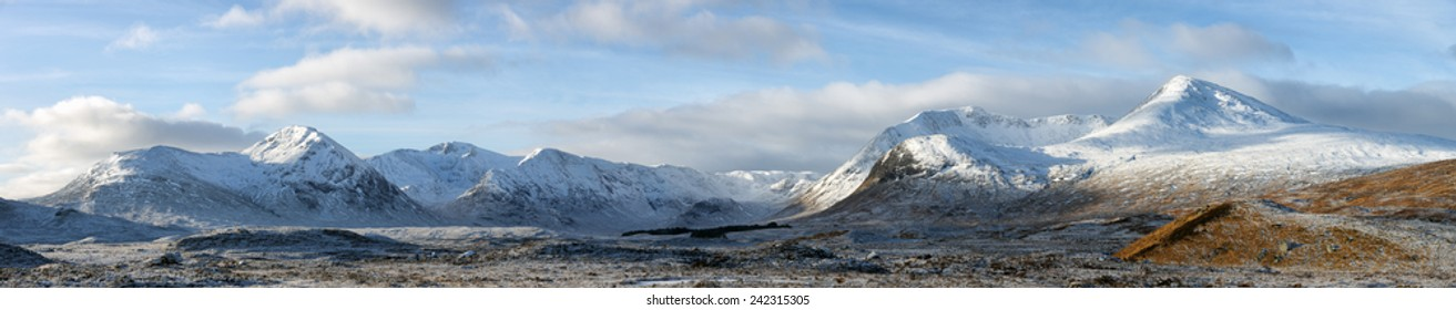 A panoramic image of a snow covered mountain range called the Black-mount, Glencoe, Scotland.