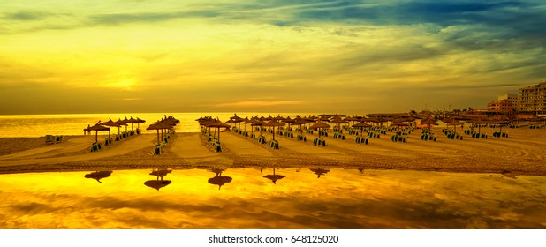 Panoramic image of sunrise on the beach in Mallorca. Europe. Spain