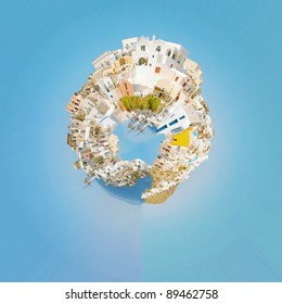 A panoramic image of the village of Oia on the greek island of Santorini made into the shape of a planet.