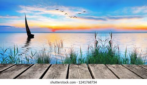 Panoramic of a lake at sunrise