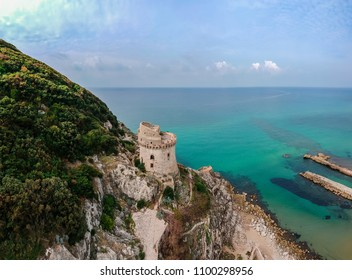 Panoramic landscape with ancient tower in Sabaudia, Lazio, Italy. Scenic resort town village with nice sand beach and clear blue water. Famous tourist destination in Riviera de Ulisse
