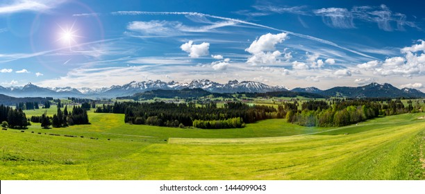 panoramic landscape in Bavaria with alps mountain range