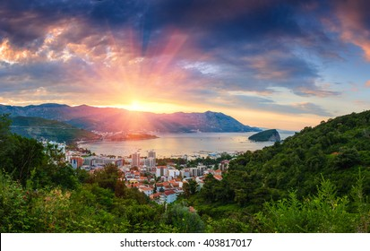 Panoramic landscape of Budva riviera in Montenegro. Dramatic morning light. Balkans, Adriatic sea, Europe. View from the top of the mountain.