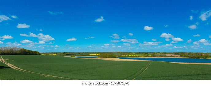 panoramic landscape with canola fields in schleswig-holstein