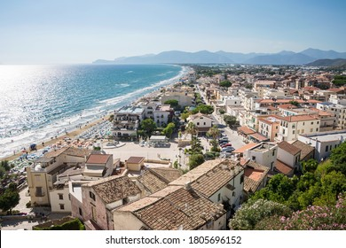 Panoramic landscape of the city and the beach od Sperlonga at sunset. Aerial view. Italian coastline.