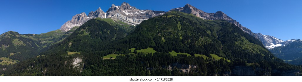 A panoramic landscape of the Dents du midi mountain chain in Valais, switzerland, taken from Champ�©ry village.