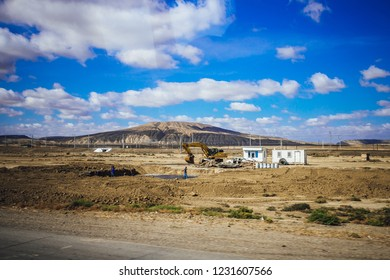 Panoramic landscape of desert and mountains in Gobustan region, Azerbaijan. Modern buildings in desert area.