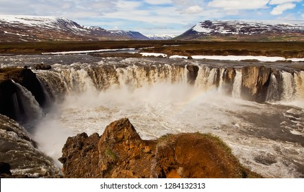 panoramic landscape of godafoss and rainbow viewed at eastern bank iceland