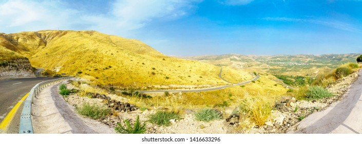Panoramic landscape of the Golan Heights, winding road 98, and the Yarmouk River valley, near the border between Israel and Jordan