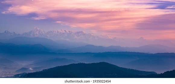 Panoramic landscape of great Himalayas mountain range during an autumn morning from Kausani also known as 'Switzerland of India' a hill station in Bageshwar district, Uttarakhand, India. - Shutterstock ID 1935022454