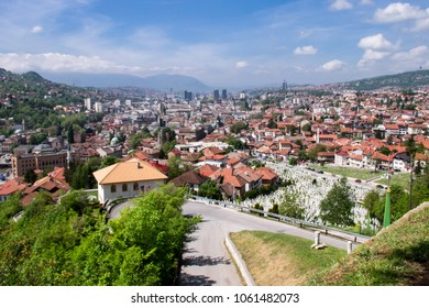 The panoramic landscape of the hills and mountains surrounding the valley of Miljacka river and the cityscape of beautiful multicultural city of Sarajevo, the capital of Bosnia and Herzegovina