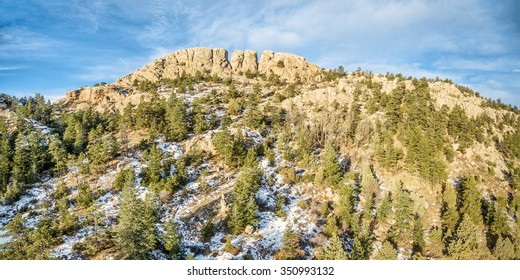 panoramic landscape of Horsetooth Rock, a landmark of Fort Collins, Colorado, winter scenery with some snow