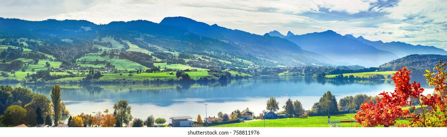 Panoramic landscape of lake Gruyere in Switzerland. Canton Fribourg, Switzerland