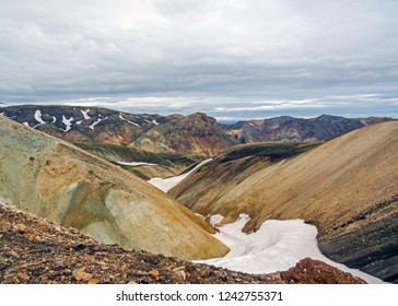 Panoramic landscape of Landmannalaugar geothermal area with colourful rhyolite mountains and black lava fields, summer view of Fjallabak Nature Reserve, Iceland