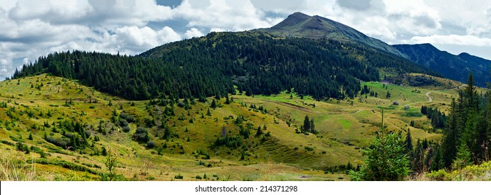 Panoramic landscape with low hills which are covered with forest