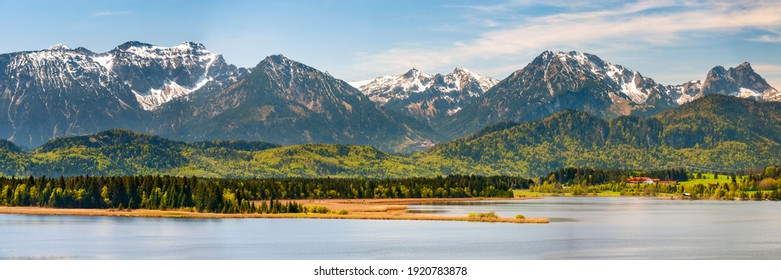 panoramic landscape with meadow and lake in Bavaria, Germany, at springtime