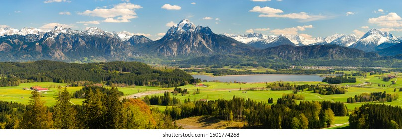 panoramic landscape with mountain range and meadow