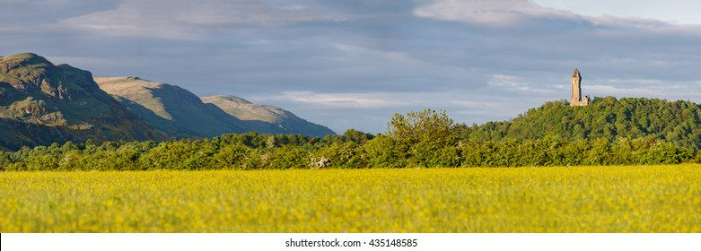 Panoramic landscape near the city of Stirling with the Ochil Hills on the left and the National Wallace Monument on the top of Abbey Craig on the right. Scotland, UK.