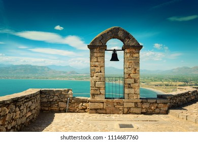 Panoramic landscape with old belfry at the top of Palamidi fortress in Nafplio, Peloponnese, Greece