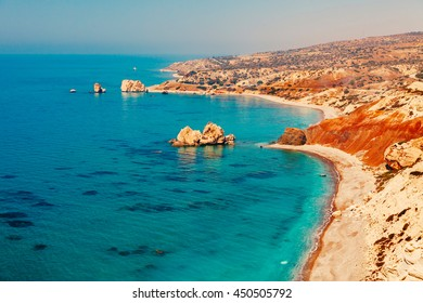 Panoramic landscape Petra tou Romiou (The rock of the Greek), Aphrodite's legendary birthplace in Paphos, Cyprus island, Mediterranean Sea. Amazing blue green sea and sunny day.