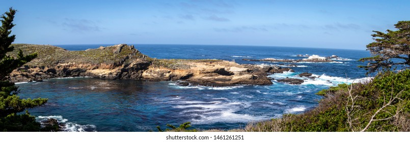 A panoramic landscape of Point Lobos State Natural Reserve in Monterey, California.