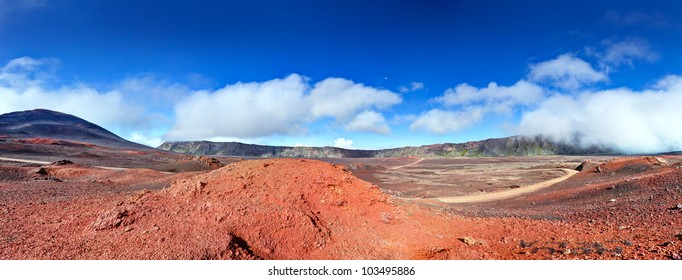 Panoramic landscape of road in volcanic landscape of Plaine des Sables, Reunion Island National Park.