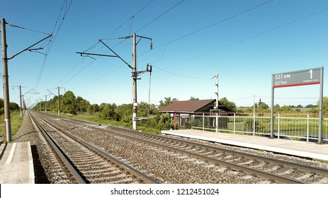 Panoramic landscape rural summer view on electrified railroad 2 way track with small station platform named 527 km in central europe russia landmark transportation train travel tourism vacation scene