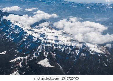 Panoramic landscape scene. Airplane shadow. Winter snowy mountains.