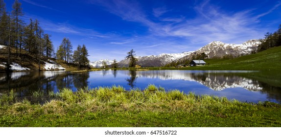 Panoramic Landscape scenery. High mountain lake in North Italy.