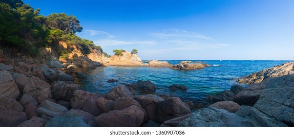Panoramic landscape sea coast in Costa Brava, Lloret de Mar, Spain. Seascape of rocky beach on mediterranean sea. Beautiful view on sea shore at afternoon