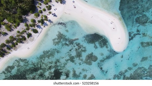 Panoramic landscape seascape aerial view over a Maldives Male Atoll island. White sandy beach seen from above.