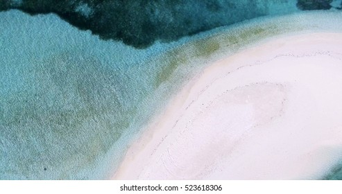 Panoramic landscape seascape aerial view over a Maldives Male Atoll island and empty white sandy shore coastline beach