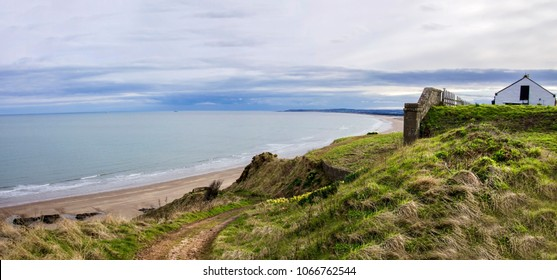 Panoramic landscape of St Cyrus seaside with house on the cliffs. Aberdeenshire, Scotland, UK.