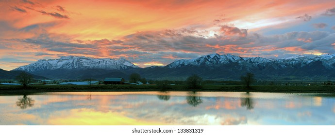 Panoramic landscape of a sunset sky in the Wasatch Mountains, Utah, USA.