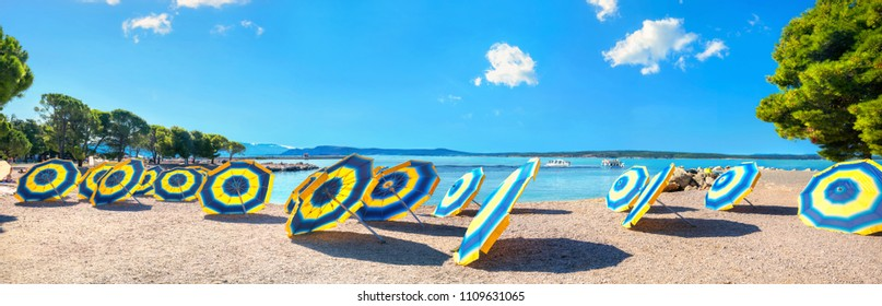 Panoramic landscape with sunshades on the beach in Crikvenica town. Kvarner bay, Croatia