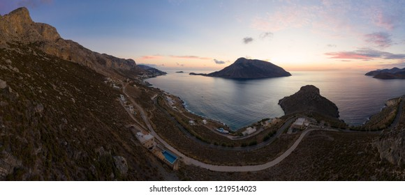 Panoramic landscape of Telendos island in distance and part of Kalymnos island at sunset, Greece, bird's eye view