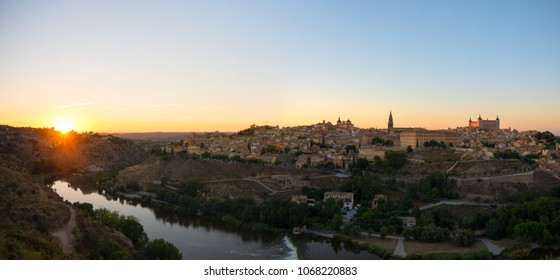 Panoramic landscape of Toledo old town and river Tajo during sunset, Spain.