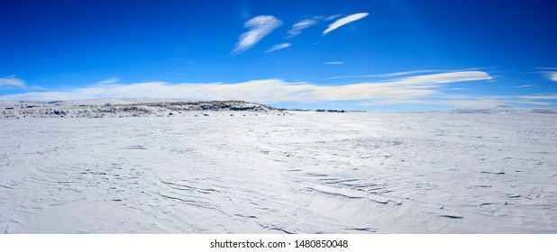 Panoramic landscape view of completely icy Lake Cildir (Turkish: Çıldır Gölü) on a sunny but freezing cold day. Ardahan - Kars / Turkey