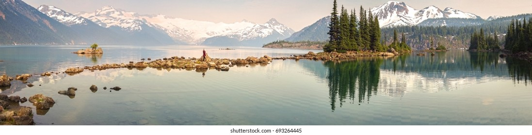 Panoramic Landscape View of Garibaldi Lake in Coast Mountains of British Columbia Canada with distant Sphinx Glacier obscured by haze from summer wildfires
