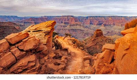 Panoramic landscape view of Grand canyon with person for scale, Arizona, USA