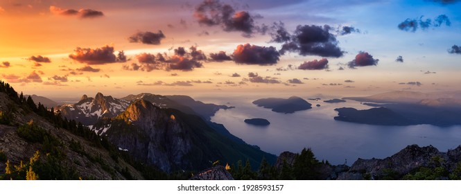 Panoramic landscape view of Howe Sound during a vibrant summer morning. Dramatic Sunrise Sky Art Render. Taken from the top of Brunswick Mountain, North of Vancouver, BC, Canada. Nature Background