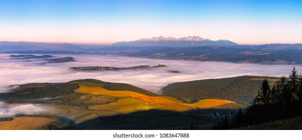 Panoramic landscape view of meadows, Spis castle and High Tatras mountain range, Slovakia