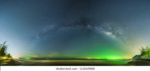 Panoramic Landscape view of Milky way in night sky over beach, Thailand