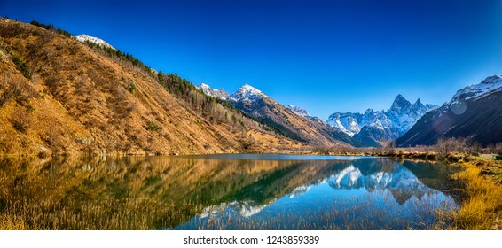 Panoramic landscape, view on beautiful autumn mountain lake Tumanly-kel, the Mist lake, located in Russia, near Dombay , in Caucasus mountains, Gonachkhir gorge