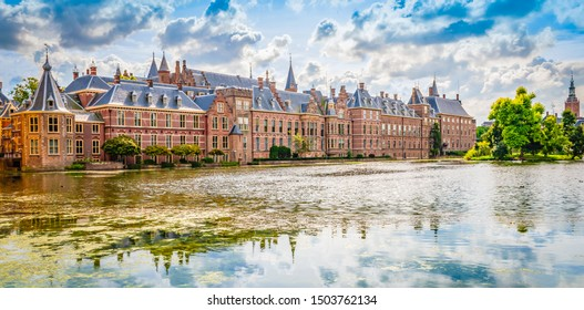 Panoramic landscape view with popular parliament building of the Binnenhof at a beautiful pond ( Hofvijver), The Hague (Den Haag), The Netherlands.