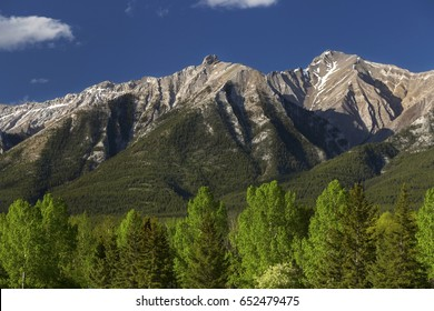 Panoramic Landscape View of Rugged Mountain Tops above Canmore Alberta near Banff National Park in Canadian Rockies