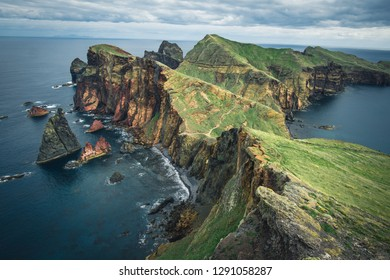 Panoramic landscape view of a Scenic the red rock canyons during a vibrant sunny day. Walking in Madeira - Ponta Sao Lourenco