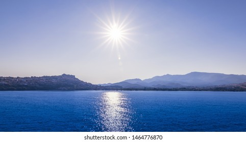 Panoramic landscape view with sunset above the Aegean sea near Molyvos, Greece. Blue tone.