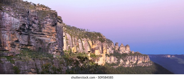 Panoramic landscape view of The Three Sisters rock formation in the Blue Mountains of New South Wales, Australia, on the north escarpment of the Jamison Valley.